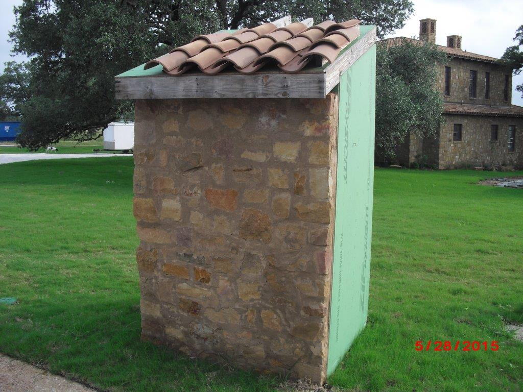 Portable Toilet Enclosure Escondido (1) Shows the street facing side with stone, masonry, and a tile