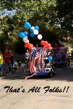 A golf cart with red, white and blue balloons driving away