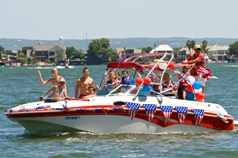 A speed boat on the water, decorated for the 4th of July