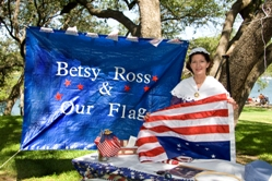 A woman holding an America Flag