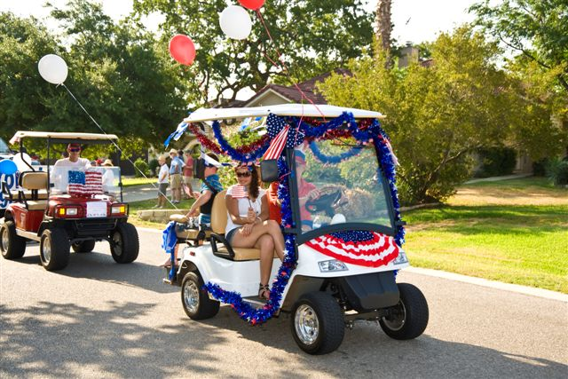 Golf carts, decorated for the 4th of July, in the parade