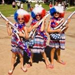 3 girls in 4th of July costumes posing with American Flag guitars