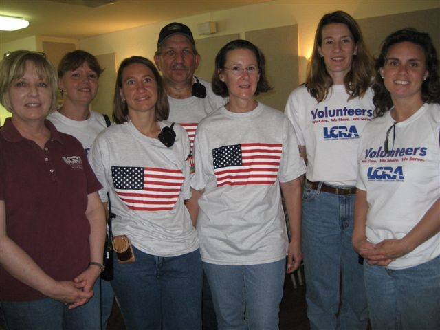 A group of people with american flag shirts smiling